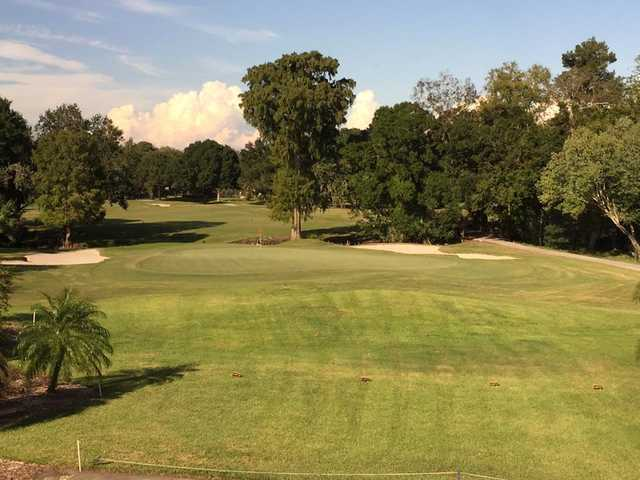 A sunny day view of a green at Cypress Run Golf Club.