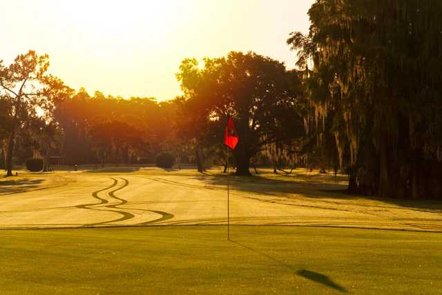 A sunny day view of a hole at Seven Springs Country Club.