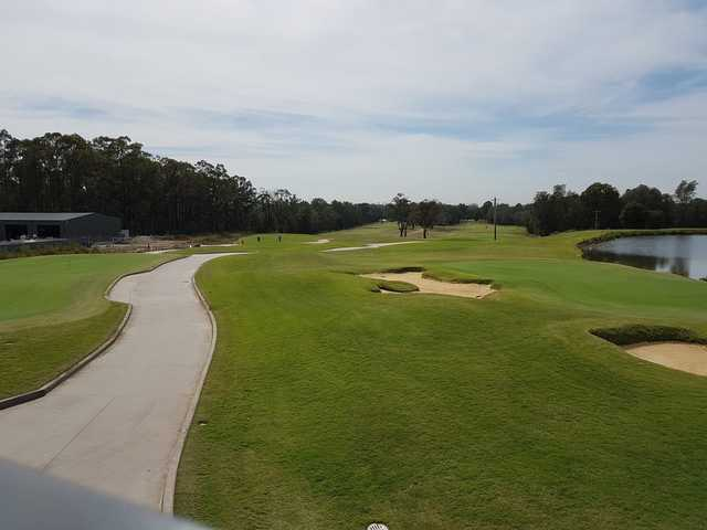 A view of a green with water and bunkers coming into play at Brighton Lakes Recreation & Golf Club.