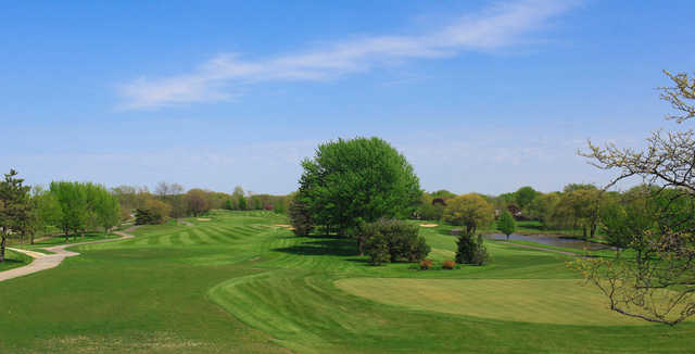 A sunny day view from Arlington Lakes Golf Club.