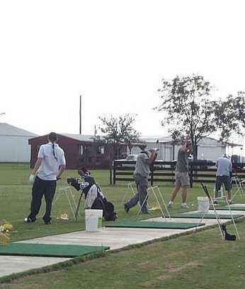 A view of the driving range tees at Austin Bayou Golf Course & RV Park