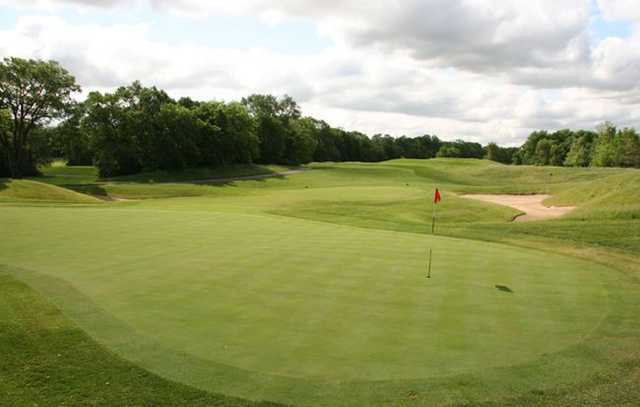 A sunny day view of a hole at Heritage Bluffs Public Golf Club.