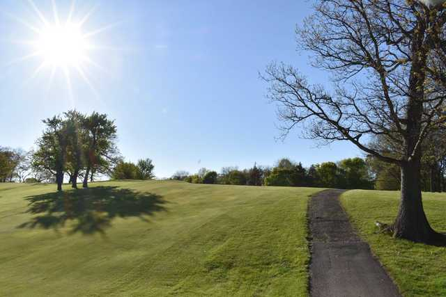 A sunny day view of a fairway at Lake Barrington Shores Golf Club.
