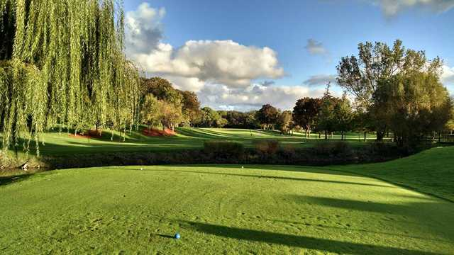 A sunny day view from a tee at Tam O'Shanter Golf Course.
