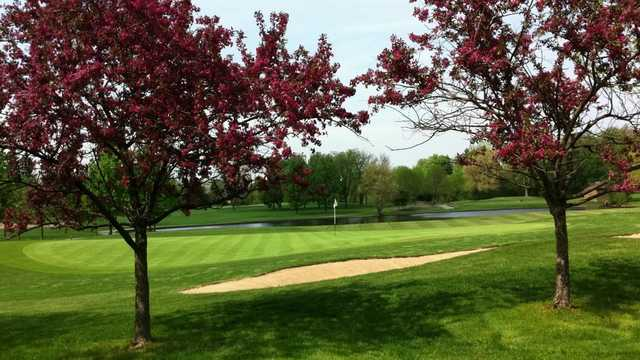 A spring day view of a hole at Oak Brook Golf Club.