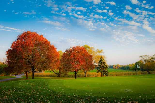 A splendid fall day view of a green at Oak Brook Golf Club.