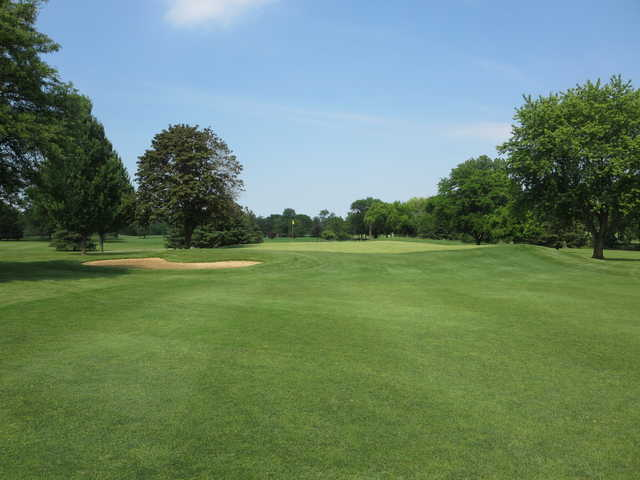 A sunny day view of a hole at Palatine Hills Golf Course.