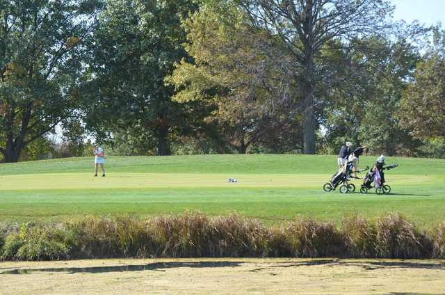 A sunny day view of a hole at Hickory Point Golf Course.