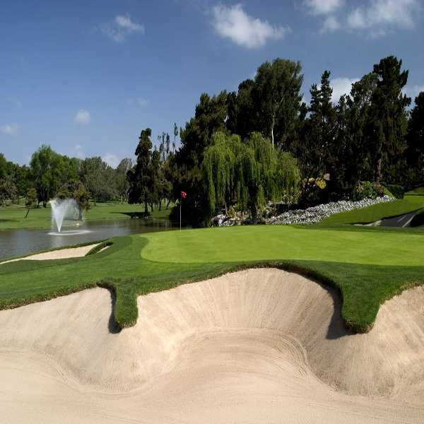 A view of the 16th green with bunkers in foreground at Omni La Costa Resort & Spa - Champions Course