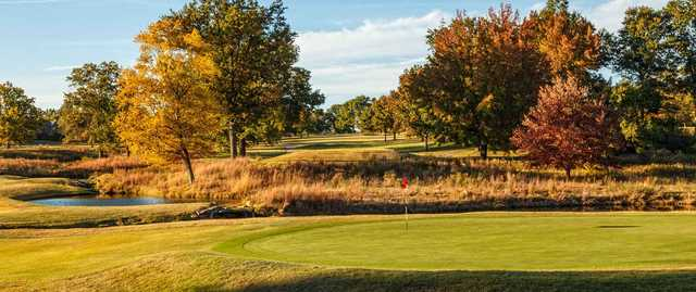 A fall day view of a green at Meadowbrook Country Club.