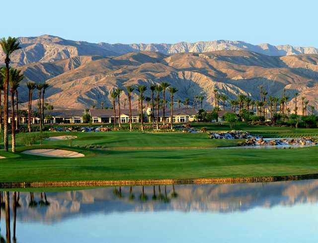 A view of a green and the clubhouse at Mountain Vista Golf Club