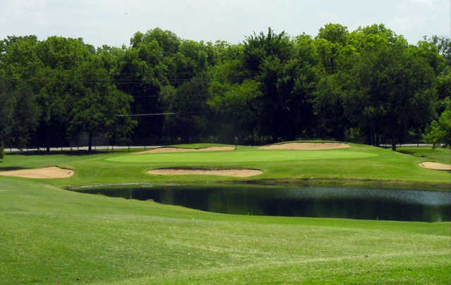 A view of a green surrounded by bunkers at Thorntree Country Club.