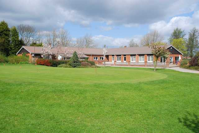 View of the puttin green and clubhouse at Edwalton Golf Centre.