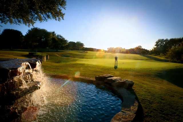 A sunny day view of a green at Avery Ranch Golf Club.