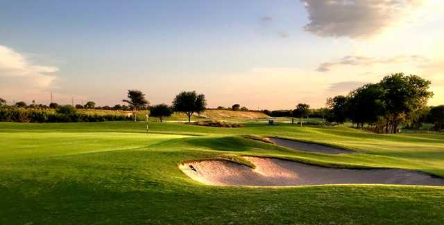 A sunny day view of a green at Star Ranch Golf Course.