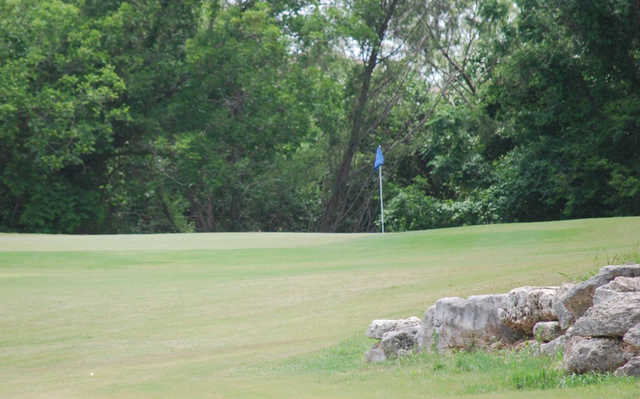 A sunny day view of a hole at Cowan Creek Golf Course.