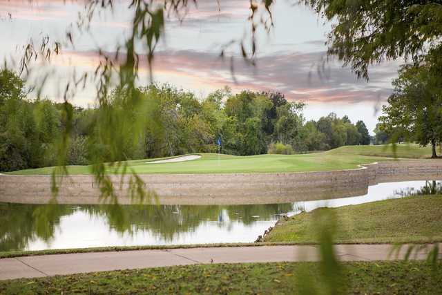 A view over the water of a hole at Sweetwater Country Club.