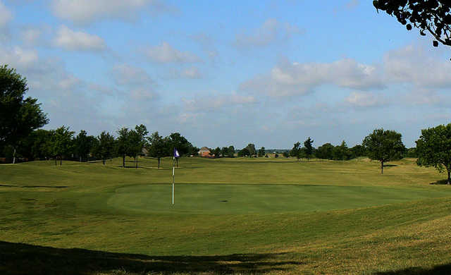 A sunny day view of a green at Waterview Golf Club.