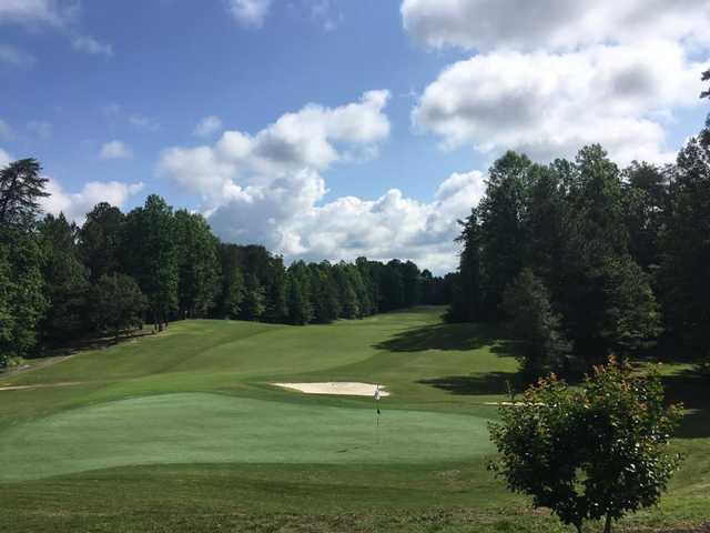 A sunny day view of a hole at Augustine Golf Club.