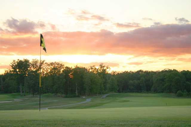 A sunset view of a hole at Pleasant Valley Golf Club.