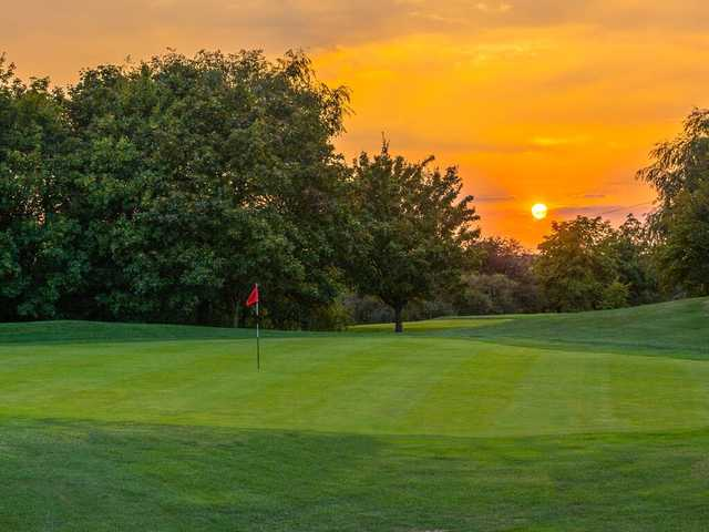 Sunset view of a green at Mowsbury Golf Club