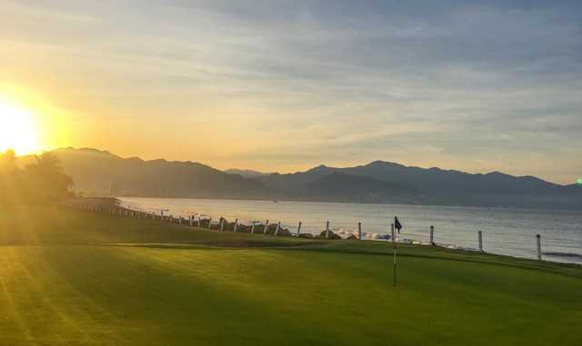 A sunny day view of a green at Marina Vallarta Golf Club.