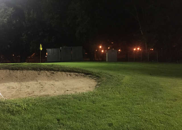 An evening view of a hole at Flushing Meadows Pitch & Putt.