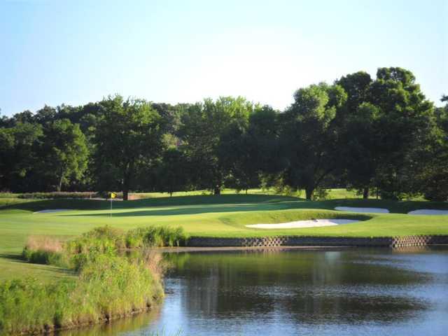 A sunny day view of a hole at Arrowhead Golf Club.