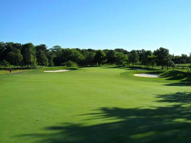 A view of a green flanked by bunkers at Arrowhead Golf Club.