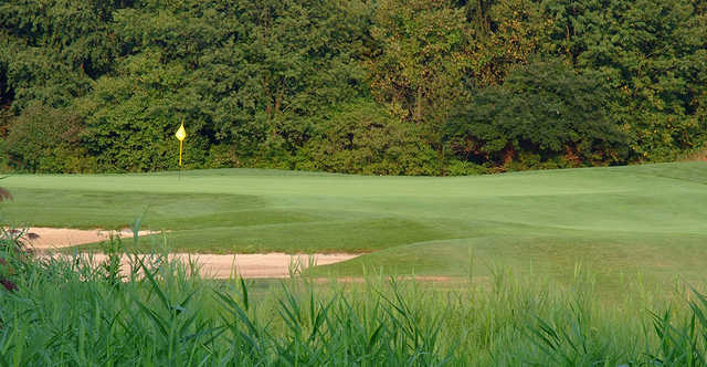 A sunny day view of a green at The Sanctuary Golf Club.
