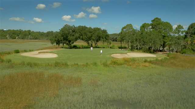 A view of a hole flaked bu bunkers at Moss Creek Golf Club.