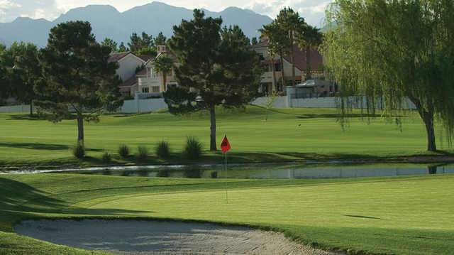 A sunny day view of a hole at Spanish Trail Country Club.