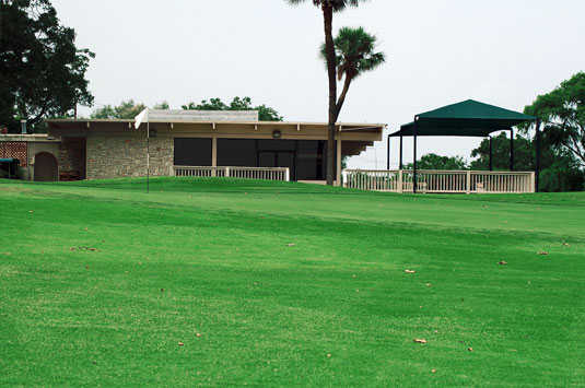 A view of the clubhouse with green in foreground at Willow Springs Golf Course