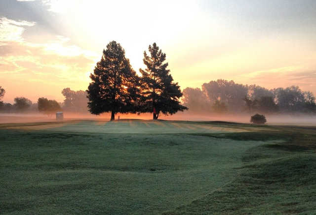 A sunset view of a green at Legacy Golf Course.
