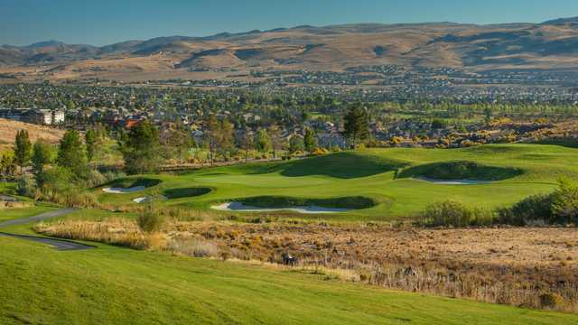 A view of a green surrounded by a collection of bunkers from Hills Course at Red Hawk.