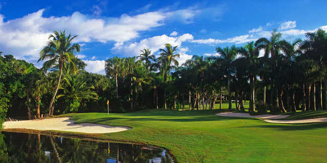 A view of a green with water and bunkers coming into play at Jupiter Island Club.