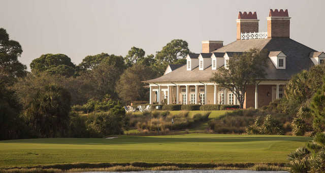 A view of a green and the clubhouse at Old Collier Golf Club.