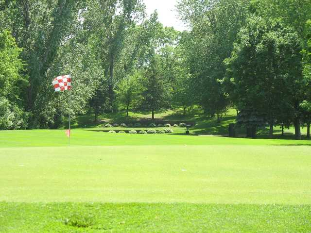 A sunny day view of a hole at New Hope Village Golf Course.