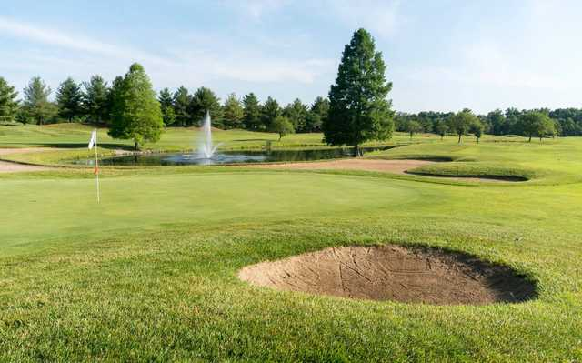 A view of a hole with water and bunkers coming into play from  Covered Bridge Golf Club .