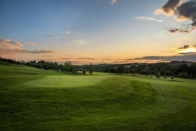 A sunset view of a green at Norwood Park Golf Centre.
