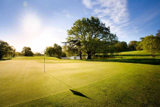 A sunny day view of a green at Norwood Course from Norwood Park Golf Centre.