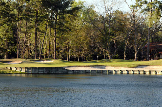 A view over the water of a hole at Old Carolina Golf Club.