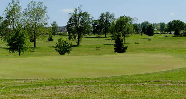 A sunny day view of a hole at Bill & Payne Stewart Golf Course.