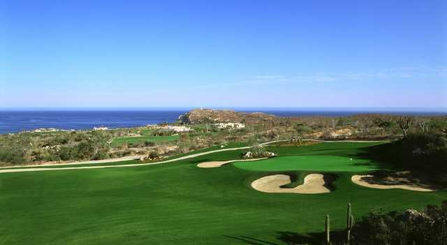 A sunny day view of a hole at Desert Golf Course from Cabo del Sol.
