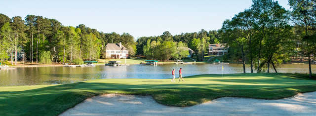 A view of a hole with water in background from Harbor Club on Lake Oconee.