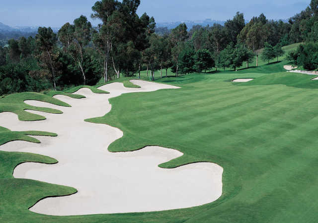 A view of the 17th fairway with an elegant bunker on the left side at Marbella Country Club.