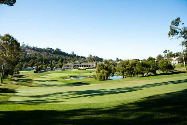 A view of a green and the clubhouse at Marbella Country Club.