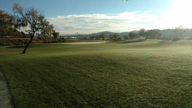 A sunny day view of a green at Fox Run Golf Course.