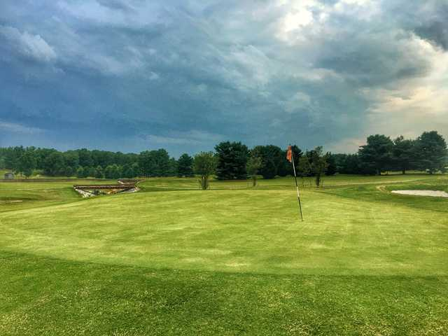 A cloudy day view of a green at Andrew Johnson Golf Club.
