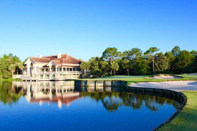 A view of the clubhouse and a green at Regatta Bay Golf & Yacht Club.